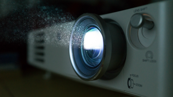 Hausstaubpartikel-Beamerlicht