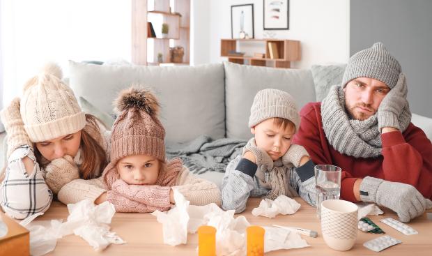 Junge Familie mit Grippe